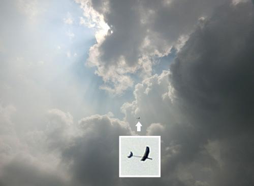 kh-18、オバハンの方、 その1。 雲がスゲェ。