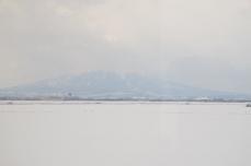 雪が残る津軽平野